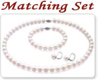 white colored pearl necklace, pearl bracelet, and a pair of pearl earrings