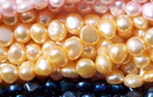 white 5-6mm baroque shaped pearl strands in various colors