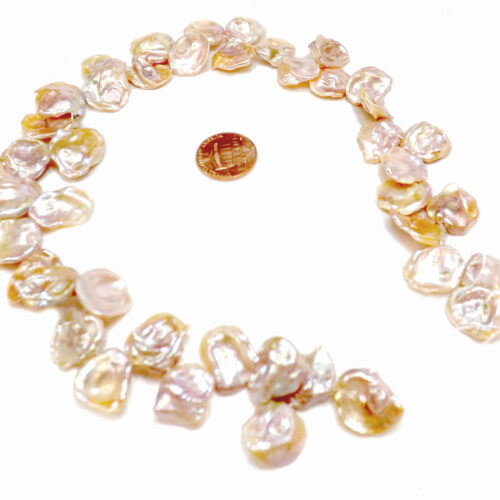 Mauve colored large keshi pearl strand