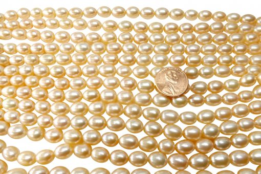 8-9mm pink colored rice or oval shaped pearl strands