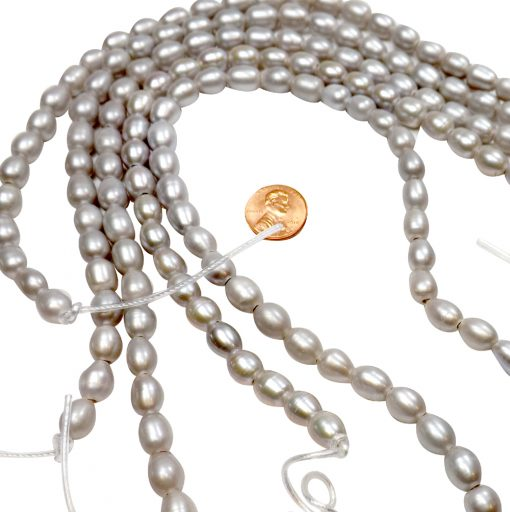 grey colored rice pearl strands with 2.5mm holes