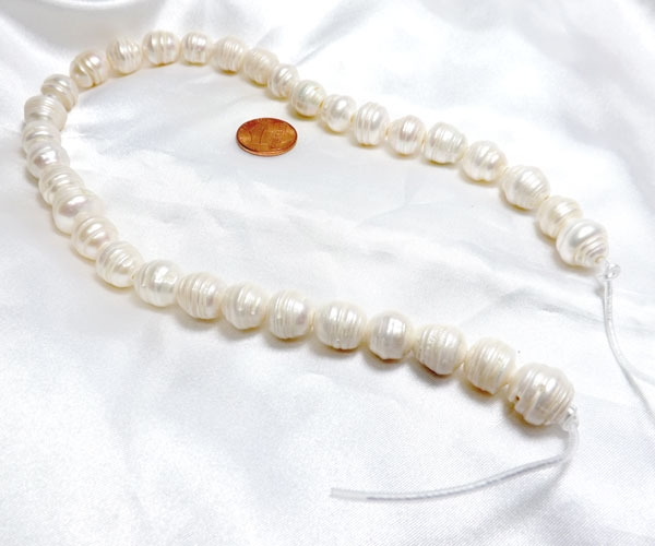 White 12-13mm Rice Pearl Strand with Natural Dents,2.3mm hole