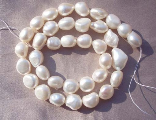 White 10-11mm Length Drilled High Quality Baroque Pearl Strand