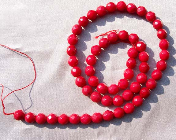 Red 7mm Faceted Round Coral Beads on Temporary Strand