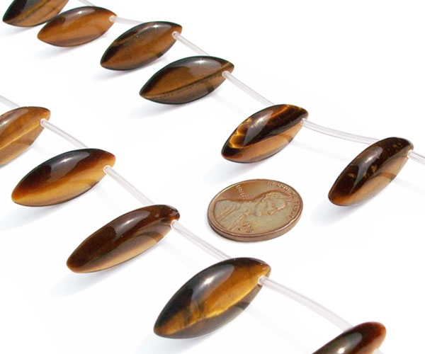 Tigers Eye 10x25mm Horse Eye Shaped Beads on Temporary Strand