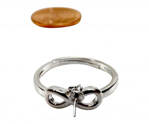Pearl ring mounting in a dangling setting
