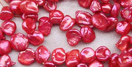 red keshi pearls