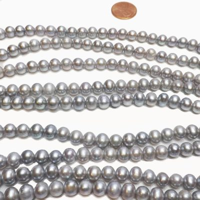 grey colored semi round pearl strand
