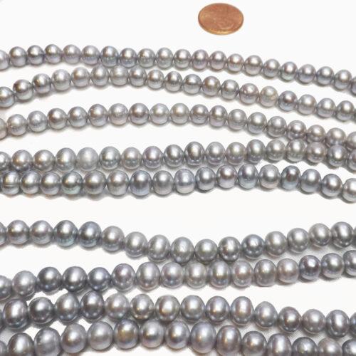 grey colored semi round pearl strand