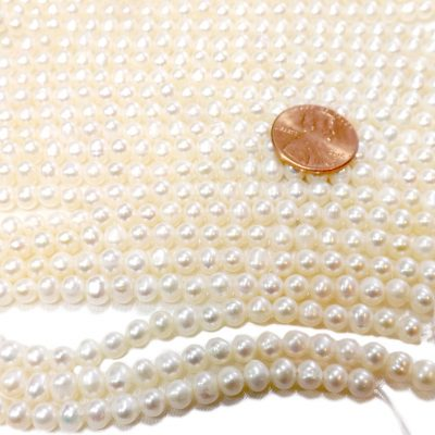 4-5mm semi-round pearl strands drilled with 0.9mm holes